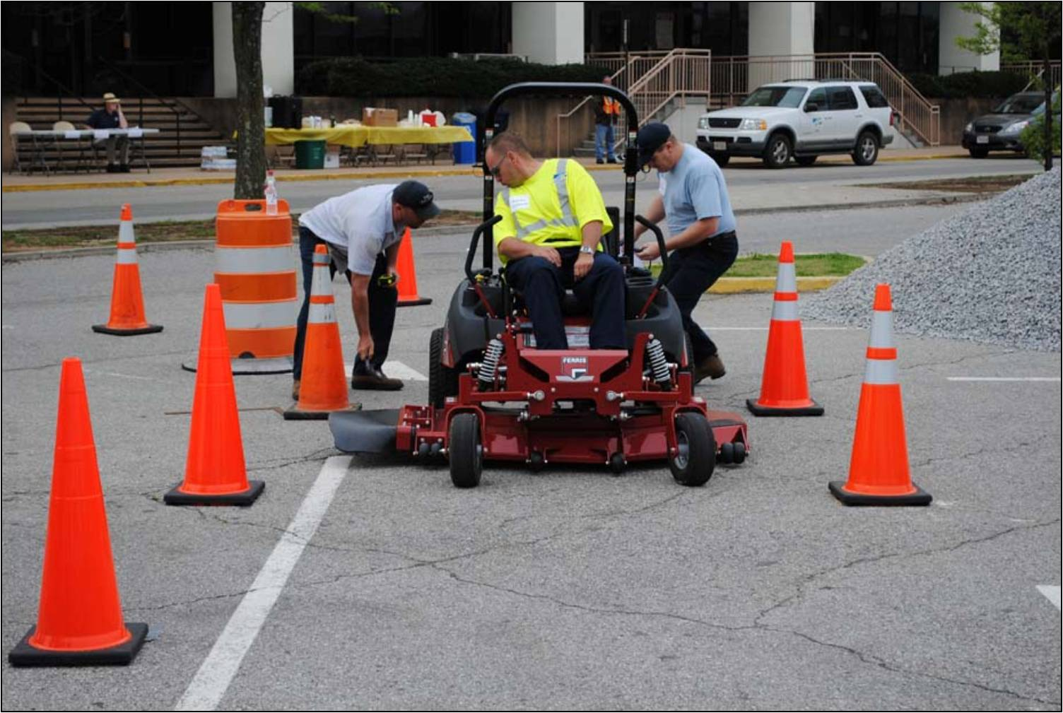 Town of Vinton employees Kevin and Mike measuring up the competition in the Zero Turn Mower event.